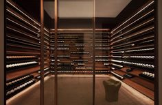 this is an amazing modern wine cellar    Ipês House by StudioMK27