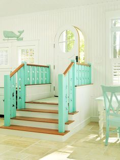 Team Approach Rapisardi and her husband, Richie, designed the stair balustrades, then painted them aqua to help break up the white in the entryway. Cherry treads recall ship ladder details. #ShadesOfSummer