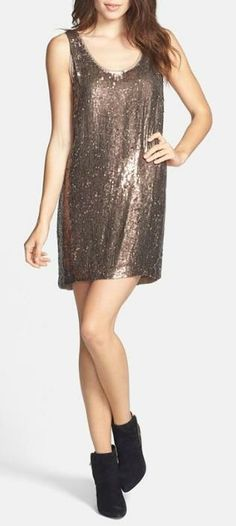 This dress is getting us excited! Gold, sequin, silk shift dress