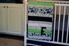 A stripe and monogram quilt by newlywoodwards, via Flickr