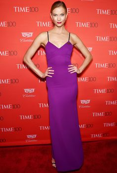 Karlie Kloss is wearing a royal purple Victoria Beckham dress. I love the color and the simplicity of this dress.