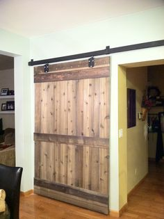"""My mother-in-love did this! """"I removed the desk that was built in and built this barn door.  Instead of paying a fortune for the hardware I went to our local Murdock's and purchase barn door hardware and painted it.  The door is made of new Cedar that I rolled with Apple Cider Vinegar."""""""