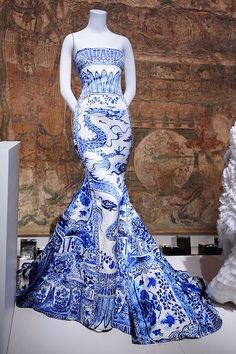 """Blue dragon print dress by Roberto Cavalli is seen on display at the Metropolitan Museum of Art's """"China: Through the Looking Glass"""" presentation in New York City http://tomandlorenzo.com"""