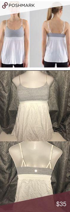 Lululemon bliss tank size 6 Gray and white stripes. Size 6. Lululemon symbol on back. Adjustable straps. No pads. Has holes for pads. lululemon athletica Tops