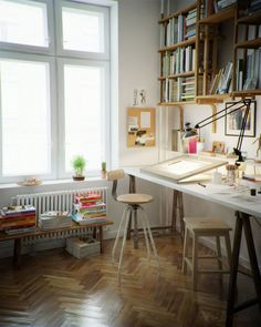 Beautiful Home Offices & Workspaces. Love that light table and the hanging bookshelves.