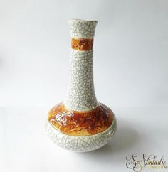 Exceptional Chinese pottery crackle glazed vase with deer scene. 40s long neck vase in white with cognac brown belts, one of them showing abstract deers in a raised pattern. Made in the Republic of China. This is an awesome vase that goes in many interiors. Winter or Christmas themed vase, too! In good condition. By SoVintastic, € 20.-
