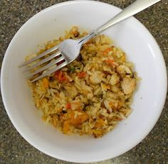 Chicken Alfredo and Rice Casserole, my adaption.    The flavors of Homemade Alfredo Sauce, Toasted Slivered Almonds, Chicken, Wild Rice, White Rice and Roasted Sweet Peppers all combine to make a scrumptious meal.  My picky children even asked for seconds.