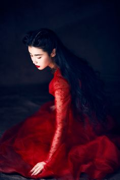 Lost in a reverie, the brush strokes appearing in her mind, the inked landscapes of the southern mountains. She is #theCalligrapher  Zhang Xin Yuan by Wang Feng