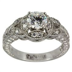 Vintage Engagement Ring- I'm in love with the ring setting... But I hate round diamonds as the main diamond... Put a princess or cushion cut in it and it would look perfect