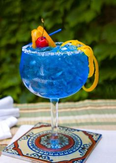 Cocktail recipe for a Blue Margarita, a blue mixed drink of tequila, blue curacao and lime juice.
