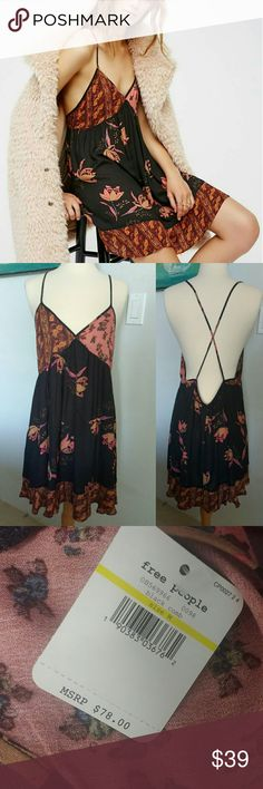 Sz M Free People Intimately All Mixed Up Slip On website for $49 right now.  So pretty mixed print slip with a cute crisscross back detail and a sweet swingy shape. V-neckline. Lightweight, Semi-sheer.  Intimately  100% Rayon Machine Wash Cold Import Free People Dresses Mini