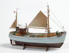 The Billing Boats 1/33 Fishing Boat Mary Ann wooden ship model measures 55cm long, 43cm high and 16cm wide. This wooden boat kit is highly realistic with many fine details.