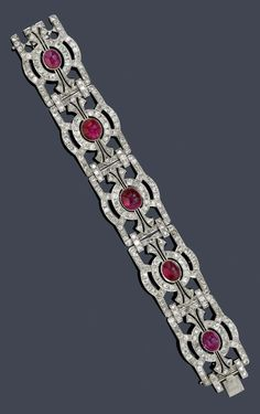 An Art Deco white gold, Burmese ruby and diamond bracelet, circa Composed of five geometrically designed sections, set with 310 old mine-cut diamonds, each section centring a Burmese ruby cabochon. Art Deco Jewelry, Modern Jewelry, Gold Jewelry, Vintage Jewelry, Fine Jewelry, Jewellery, Lotus Jewelry, Jewelry Design, Diamond Bracelets