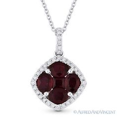 The featured pendant is cast in 18k white gold and showcases a pendant adorned with oval cut & princess cut red rubies set at the center of halo settings adorned with round cut diamond accents.   #diamonds #18kjewelry #18kgold #whitegold #ruby #pendant #necklace