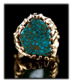 Ultra high grade natural Red Mountain Spiderweb Turquoise in a 14k gold ring created by John Hartman of Durango Silver Company. John hand cut the stone from the Durango Silver Collection and created the Mens Ring as well. This Ring was priced around $6000.00 and has been sold.