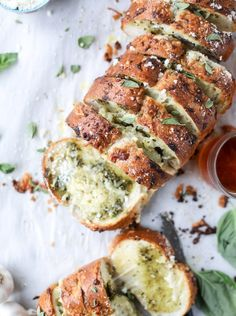 cheesy stuffed pesto garlic bread @howsweeteats