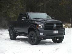 All black Dodge Ram 1500 --- Wayna loves deez.