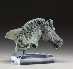 Hellenistic Bronze Horse Head Fulcrum Fragment, 1st Century BCW/ much of the original silvering and one core-formed glass eye