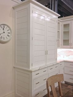 White planked kitchen cabinets