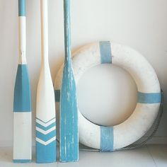 sea blue colour oars and life ring