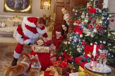 Caught red-handed – Cheeky Prince Harry dons a Santa outfit to surprise the family with a sneaky sack of gifts under the tree