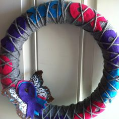 Argyle thyroid cancer awareness wreath in pink, teal, purple with signature butterfly