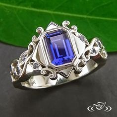 Custom 14kt X-1 organic bezel set Emerald cut blue sapphire. Picture frame style setting with open pierced organic vine and leaf band. - See more at: http://www.greenlakejewelry.com/gallery/cust_gallery.aspx?ImageID=73959#sthash.YhporOyw.dpuf