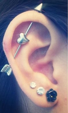 An industrial piercing with an arrow and cute heart. on The Fashion Time http://thefashiontime.com/5-cute-fun-ear-piercing-ideas/#sg14