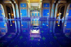 Newspaper megastar William Randolph Hearst was so rich that his house had two pools: The outdoor Neptune pool, and the indoor Roman pool pictured above.  Never one for being over-the-top, Hearst used real gold in the tiles. So THAT'S why print is running out of money.