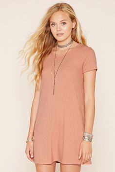 Style Deals - A ribbed knit T-shirt dress featuring short sleeves, a round…