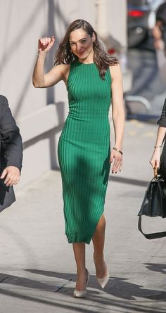 Pretty outfit ideas to wear to work this spring -- try a sleeveless, below-the-knee sweater dress with heels. Click for more outfit ideas from celebrities.