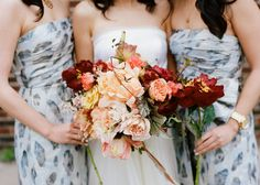 Bridesmaids with one large long stem peony bloom.