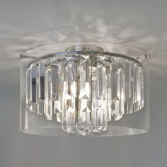 Buy this Astro Lighting Asini Round Flush Bathroom Ceiling Light IP44 3 x 33W G9 in Chrome with Crystal Droplets and Outer Glass AX7169 online from Sparks Direct at our low price of £329.88. Archway, London UK.