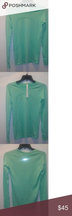 Lululemon Swifty Tech Long Sleeve Crew, Green NWOT Lululemon Swifty Tech Long Sleeve Crew, Green, Thumb holes Athletic Apperal S 6  We love a good top with thumbholes. And a shirt that's specifically meant to inhibit the growth of odor-causing bacteria? Even better. Wear this smart Lululemon long sleeve crew and worry less about stinking up the room, and more about acing your workout.  Green Made with silverescent technology Thumb Holes Long Sleeve Crew neck Excellent condition no stain…