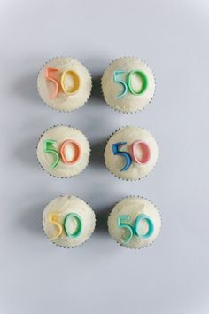 50th birthday cupcakes with fondant numbers, by RosyCakes.