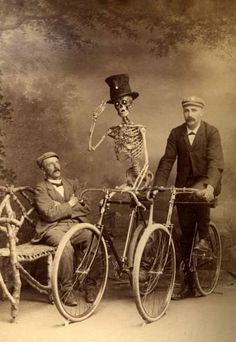Two bicycles linked together, one with a skeleton riding it.