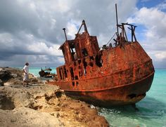 The once magnificent 'Gallant Lady' now peacefully rests against a rocky shore of paradise on the southern tip of North Bimini in the Bahamas.  Decades ago, the freighter sailed from Belize City. As bad storms came, the crew soon found themselves smashed into the shore. Years followed as the salty waves gently caresses the abandoned ship, slowing reducing it down to a skeleton of rusted steel.