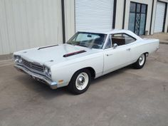 1969 Road Runner. I love the loud bright colored Mopars but these sedate plain ones just seem more sinister.