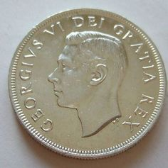 Canadian Silver Dollar (Obverse). The reigning monarch at the time of the coin's minting is featured on the front of this coin, which contains 6/10 of an ounce of silver.