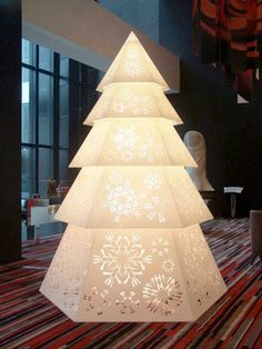 Check out the snowflakes, contemporary christmas tree installation