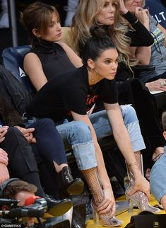 Unusual position: Kendall held onto her ankles as she enjoyed the action
