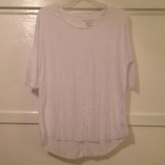 NWOT American Eagle Jegging T-shirt Never been worn. Flowy white shirt. Very soft. Fitted sleeves to elbow. Size S, will fit both S and M. Great casual shirt. I negotiate within reason, please use offer button. American Eagle Outfitters Tops Tees - Short Sleeve