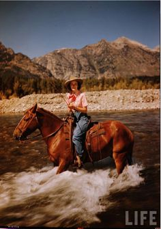 Photo woman fishing on horseback in Jackson Hole, Wyoming by Alfred Eisenstaedt via the LIFE Archives.
