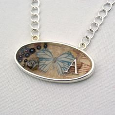 Use resin, scrapbook papers, charms, and embellishments in a pendant tray to make a unique necklace.