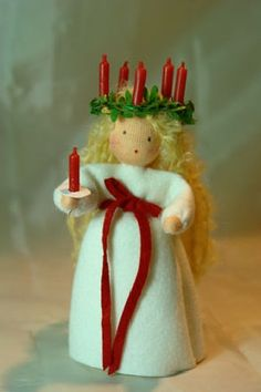 Santa Lucia... It would fun to make different saints in this style... Perhaps as ornaments on the tree.
