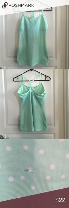 Lululemon Power Y Yoga Tank Size 6 Fitted, stretchy tank with built in sports bra, racer back, and pockets for removable inserts. However, this top does NOT come with bra inserts. Color is mint green with white polka dots. No rip tag. In good condition and does not have stains or pilling. The only flaw is a small snag on the stomach area (see 3rd pic). Price reflects wear. No trades or Paypal. lululemon athletica Tops Tank Tops