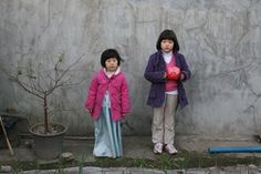 A still from So Yong Kim's film Treeless Mountain (2010) in which two tiny sisters go in search of their estranged father in South Korea.