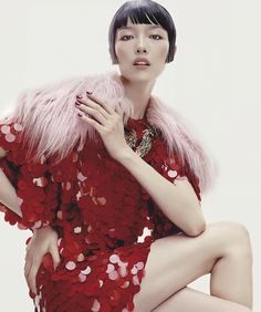Fei Fei Sun graces a special supplement cover for the October 2017 issue of Vogue Australia. Photographed by Robbie Fimmano, the Chinese stunner poses in a paillette embellished red dress from Miu Miu with a pink fur collar. In the accompanying spread, Fei Fei turns up the glam factor in statement looks from the fall...[Read More]
