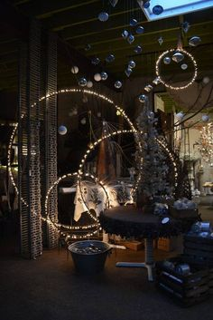 Create some very cool lighting by painting a hoola hoop black and attaching string lights!