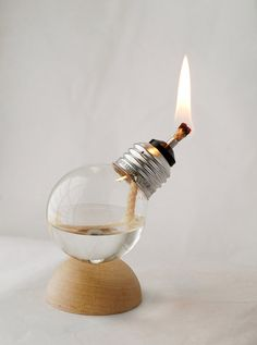 recycled light bulb oil lamp. i feel like i could make this...though maybe not the base. available on etsy.